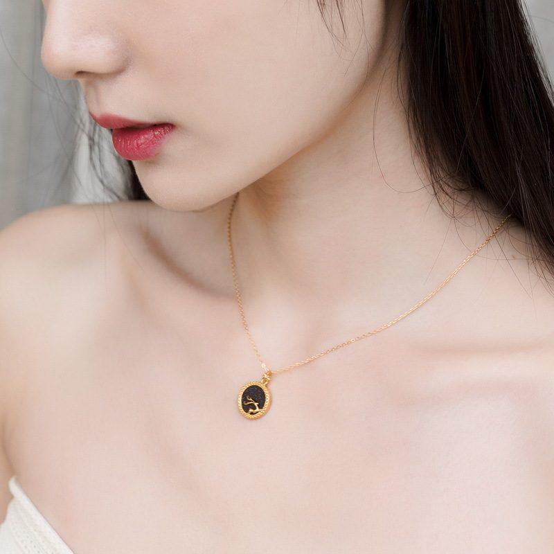 Dây chuyền bạc mạ vàng nai nhỏ trên nền pha lê xanh cát LILI_425471-1