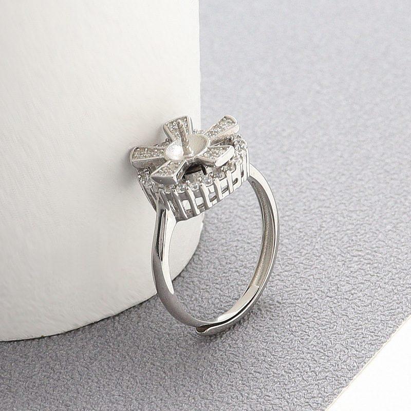 Nhẫn bạc đính ngọc trai hình cánh hoa xoay tròn LILI_821226-01